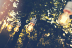 Decorative string lights for outdoor party. Hanging decorative string lights for outdoor party Royalty Free Stock Image