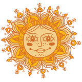 Decorative sun with human face Stock Image