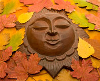 Decorative sun in leaves. Royalty Free Stock Photo