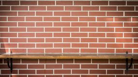 Decorative table background on a red brick wall. royalty free stock photos