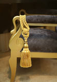 Decorative tassel. Golden tassel on decorative chair in interior stock photography