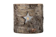 Decorative tea light as a star in wooden tree stump. Christmas t royalty free stock image