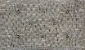 Decorative textile background with coach-type screed Capitone chesterfield texture. Beige chesterfield style quilted. Decorative textile background with coach Royalty Free Stock Image
