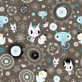 Decorative texture with kittens and snowmen. Seamless graphic pattern with kittens and snowmen on a dark brown background Royalty Free Stock Images