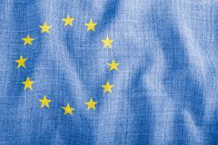 EU symbol on a background of blue wavy fabric royalty free stock photography