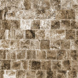 Decorative textured background wall of marble tiles Stock Images