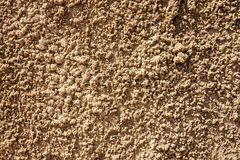 Decorative textured rugged plaster wall. Decorative textured plastered wall that looks like wet sand royalty free stock image