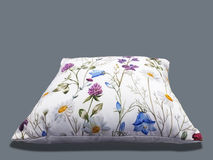 Decorative throw pillow. Decorative throw pillow with flower on gray background royalty free stock photos