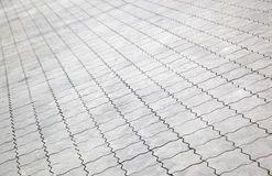 Decorative tiled floor. Angled view of decorated tiled floor receding into distance Stock Image