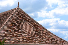 Decorative tiled roof with finial. Stock Photo