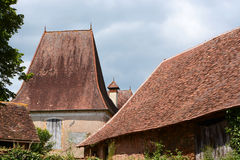 Decorative tiled rooves with finial. Royalty Free Stock Photos
