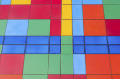 Decorative tiles on the wall. Fragment of a wall covered with colored decorative tiles Stock Photos
