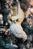 Decorative toy owl on a christmas fur-tree Stock Image