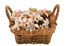 Decorative traditional wick basket. With fake flowers in it Stock Image