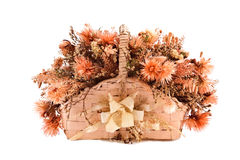 Decorative traditional wick basket with fake flowe. Rs in it Stock Photography
