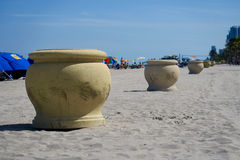 Decorative Trash Containers on Beach Royalty Free Stock Photo