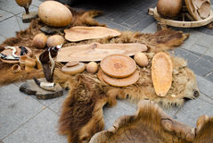 Decorative trays bowls cups of wood on bear fur Stock Photo