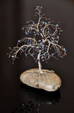 Decorative tree. On pebble with reflection Stock Photos