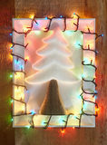 Decorative tree in christmas lights frame Royalty Free Stock Photo