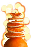 Decorative tree from orange slices with bokeh on a white backgro Royalty Free Stock Images