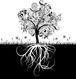 Decorative tree and roots, grass royalty free illustration