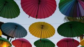 Decorative umbrellas fragment. Green pink blue yellow and rainbow decorative installation made of hanging umbrellas fragment Stock Image