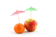 Decorative umbrellas on fruit Stock Photos