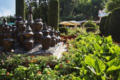 Decorative urns in a park Stock Images