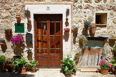 Decorative Valdemossa home. Doorway decorated with floral arrangements in Valdemossa Mallorca Royalty Free Stock Images