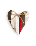 Decorative valentine heart of fabric with ribbon Stock Photos