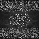 Decorative Valentine hearts on black chalkboard. Floral elements with decorative hearts and lettering Happy Valentines Day on a black chalkboard, illustration Stock Photo
