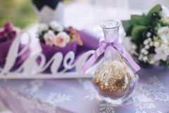 Decorative vase with yellow filling on the background of the inscription love. Decorative vase with gold filling on the background of the inscription love Stock Image