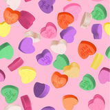 Decorative vector love elements. Seamless pattern for Valentine`s Day with colorful conversation hearts candy on a pink background. Background in pastel colors Royalty Free Stock Photo