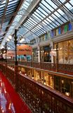 Elegant white truss glass skylight ceiling, decorated storefronts and galleries of Strand Arcade in Sydney downtown, Australia royalty free stock photo