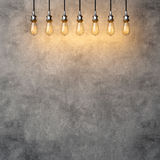 Decorative vintage lightbulbs with concrete background Royalty Free Stock Photography