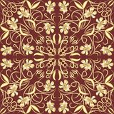 Decorative vintage tile with golden floral swirl patterns in art deco style Stock Photos