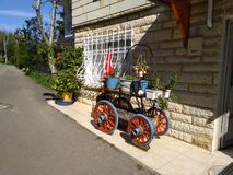 Very cute decorative wagon with flowers on it royalty free stock photos