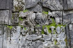 Decorative wall with carvingsand and green moss in the Sewu Temple royalty free stock photos