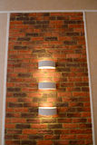The decorative wall panel  as brick with illumination of a sconce in an interior Stock Photo