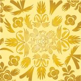 Decorative wallpaper of the gilded colour Royalty Free Stock Photos