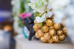 Decorative walnuts in shape of bunch of flowers Stock Images