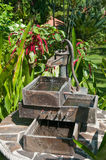 Decorative water pump. Garden fountain of water and pump Stock Images