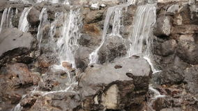 Decorative waterfall in the park stock video footage