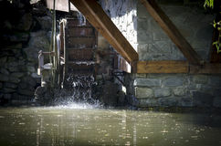 Decorative watermill wheel Stock Images