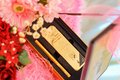 Decorative wedding gold bar. Gold bar as a wedding gift Royalty Free Stock Images
