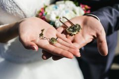 Decorative wedding lock and keys with coulomb in hands. Royalty Free Stock Images