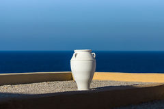 Decorative white amphora on a background of blue sky and sea. Stock Image