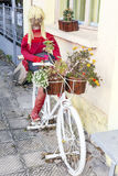 Decorative white Bicycle with flowers and doll Royalty Free Stock Photo