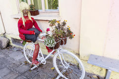 Decorative white Bicycle with flowers and doll Royalty Free Stock Images