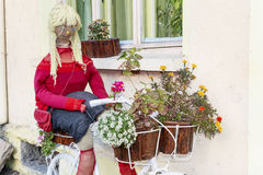 Decorative white Bicycle with flowers and doll Stock Photography